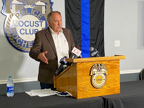 Rochester Police Locust Club President Michael Mazzeo speaks from a podium at the union's headquarters. - FILE PHOTO