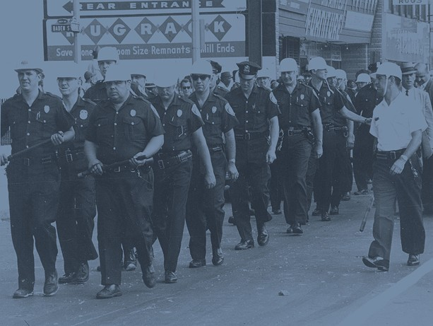 Rochester Police Department officers don helmets and batons during the riots of 1964, the same year the Rochester Police Locust Club negotiated its first labor pact with the city. - PHOTO COURTESY THE CITY OF ROCHESTER