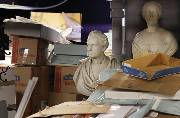 Busts of Hiram and Elizabeth Sibley sit among miscellaneous items at the Rochester Historical Society on University Avenue. - PHOTO BY MAX SCHULTE