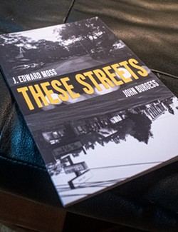 """The poetry book """"These Streets"""" by Jordan Moss and John Burgess was the impetus for the King 20/20 album of the same name. - PHOTO BY JACOB WALSH"""
