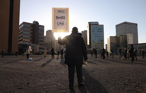 Black Lives Matter activists gathered at Parcel 5 and them marched through the streets of Rochester Tuesday, March 23, as they marked the one-year anniversary of Daniel Prude's fatal encounter with city police. - PHOTO BY MAX SCHULTE