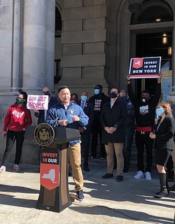 Assemlbyman Ron Kim, D- Queens spoke at a rally to celebrate the inclusion of new taxes on the wealthy and increased school funding in the state budget, at a rally outside the State Capitol on April 7, 2021 - PHOTO BY KAREN DEWITT