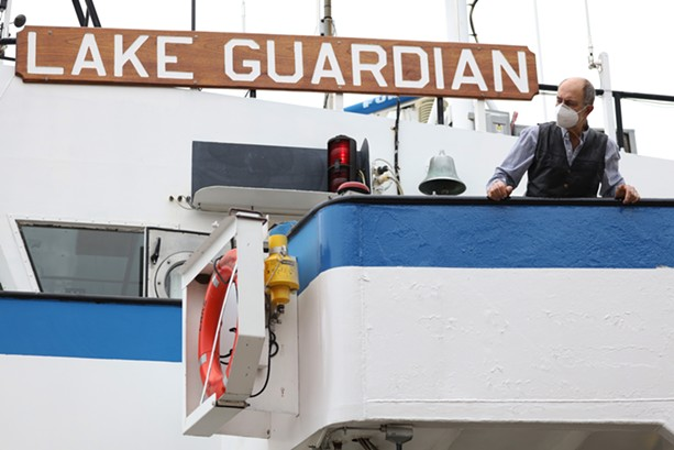 A researcher aboard the Lake Guardian. - PHOTO BY MAX SCHULTE