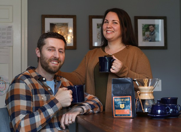 Kate and Kyle Korman at their home in Victor, where they brewed up the idea for Schittin Good Coffee while quarantining during the pandemic. - PHOTO BY MAX SCHULTE