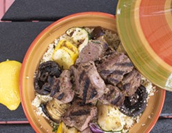 Un-skewer the meat and veggies and set them over a bed of couscous and olives. - PHOTO BY JACOB WALSH