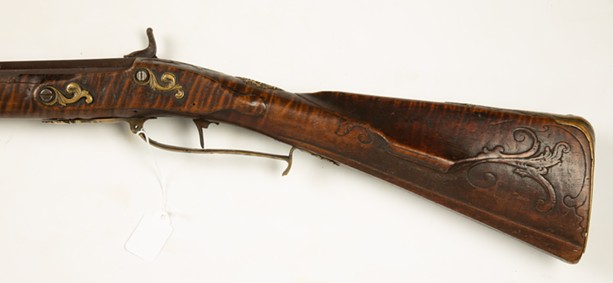 The engravings on the stock of the Rochester Historical Society's Kentucky rifle are consistent with the markings of Andreas Albrecht, an 18th-century gunsmith considered a patriarch of Kentucky rifles. - COTTONE AUCTIONS