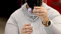 A staffer preps an injection of the COVID-19 vaccine. - PHOTO BY MAX SCHULTE / WXXI NEWS