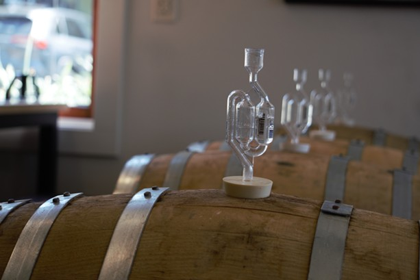 Beers ferment away in barrels inside the taproom of Pittsford's Copper Leaf Brewing. - PHOTO BY GINO FANELLI