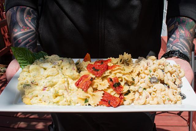 A trio of summer sides: potato salad, pasta salad, and macaroni salad. - PHOTO BY JACOB WALSH