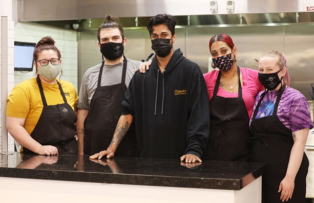Nani's Kitchen owner Meghesh Pansari, center, with staff who voted to unionize with his blessing. - PHOTO BY MAX SCHULTE