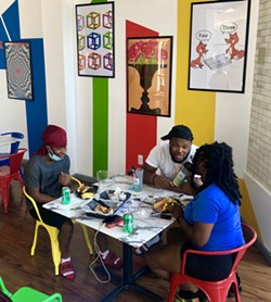 Customers dine during a lunch hour at House of Whacks. - PHOTO BY REBECCA RAFFERTY
