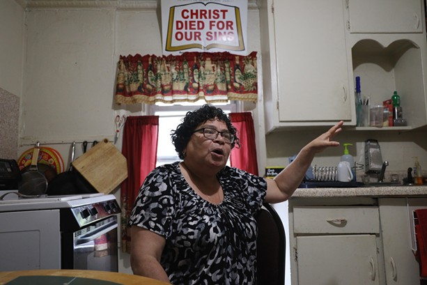 """Nancy Hernandez Maciuska, a member of the Lewis Street Committee, in her home on Finney Street. """"Everything was just taken away from us,"""" she says of the Inner Loop's impact on the neighborhood. - PHOTO BY MAX SCHULTE"""