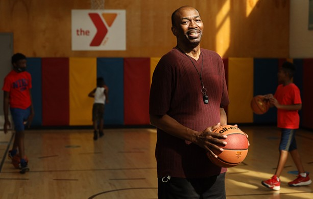 David Everett, one of the Lewis Street Committee leaders, teaches kids basketball at the YMCA Center for Equity. Everett grew up at the Lewis Street Settlement House and played basketball as a boy in the same YMCA. - PHOTO BY MAX SCHULTE