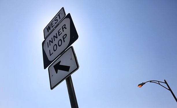 Inner Loop West sign on Scio Street in Rochester. - PHOTO BY MAX SCHULTE