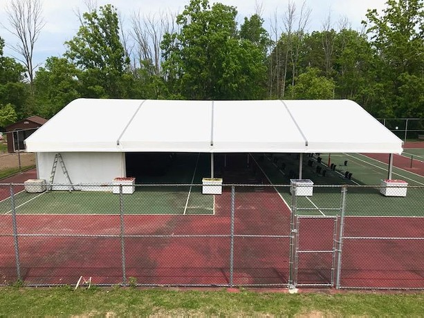 The outdoor Dawn Lipson Canalside Stage at the JCC of Greater Rochester spans two tennis courts and will host a 2021 summer arts series. - PHOTO BY DAVID ANDREATTA