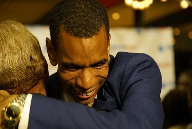 Malik Evans hugs a supporter at his campaign headquarters following declaring victory in the Democratic primary on June 22, 2021. - PHOTO BY KATIE EPNER