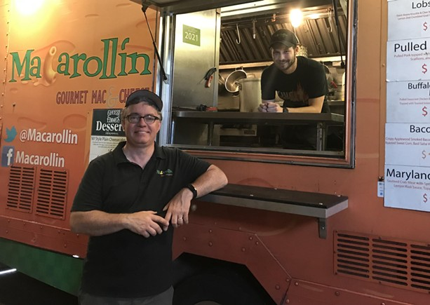 Chuck Andrews (left) and Tyler Schuber (right) of Macarollin' prepare for the Food Truck Rodeo at their warehouse. - PHOTO BY NOELLE E. C. EVANS
