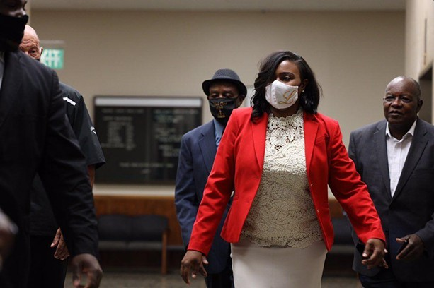 Rochester Mayor Lovely Warren arrives Wednesday morning at the Hall of Justice for arraignment on charges that include criminal possession of a firearm and endangering the welfare of a child. - PHOTO BY MAX SCHULTE