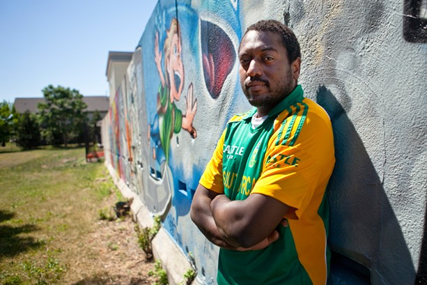 Wall\Therapy founder Dr. Ian Wilson at the Troup Street mural where the seeds of the annual festival were planted in 2011. - FILE PHOTO