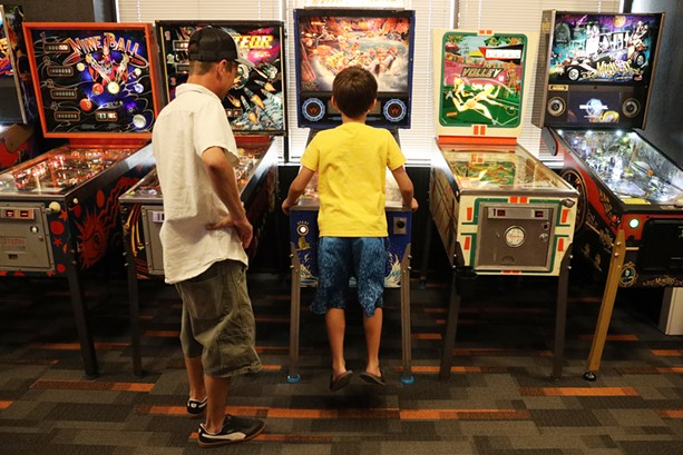Everyday adults for whom pinball is nothing more than a diversion find nostalgia at Rochester Pinball Collective, while younger visitors who have never known gaming to mean interacting with other humans in public find a revelation. - PHOTO BY MAX SCHULTE