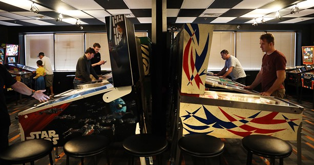 With 45 machines on display, the Rochester Pinball Collective in the Piano Works Mall is the second-largest pinball arcade in New York. - PHOTO BY MAX SCHULTE