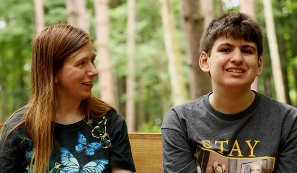 Catherine Abida and her son, Ali, at the Autism Nature Trail in Letchworth State Park. Ali was one of the inspirations for the trail after a conversation between Loren Penman and Pat Strobel, Ali's grandmother. - PHOTO BY MAX SCHULTE