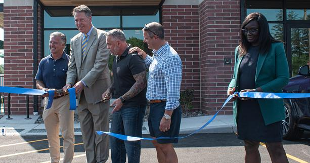 From right, Brighton Town Board member Robin Wilt, developer Danny Daniele, Starbucks store manager Ray Ballard, Brighton Supervisor Bill Moehle, developer Anthony Daniele, cut the ribbon on the opening of the Starbucks in the soon-to-be Whole Foods Plaza. - PHOTO BY JACOB WALSH