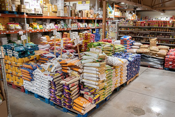 A massive variety of rice is among the dry goods available at Namaste Cash & Carry. - PHOTO BY JACOB WALSH