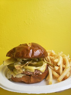 The Dilly Burger is on the menu at Misfit Treats and Eats, which recently expanded its vegan menu beyond doughuts to include savory dishes. - PHOTO PROVIDED