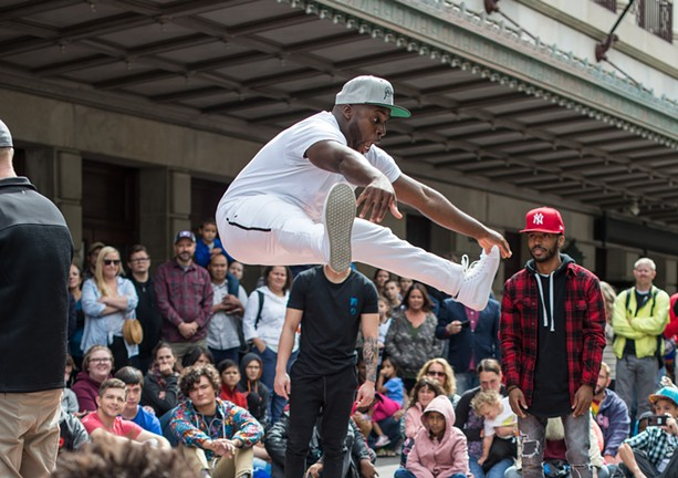 Rishone Todd dances during Fringe Street Beat as part of 2018 Rochester Fringe Festival. - PHOTO BY AARON WINTERS