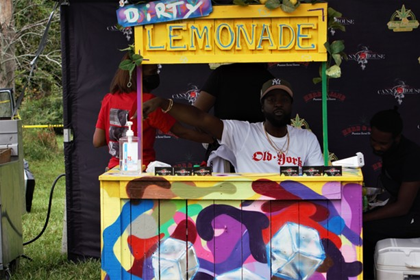 """Reggie Keith of Canna House offered """"dirty lemonade"""" at the Cannabis Carnival. - PHOTO BY GINO FANELLI"""