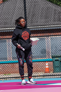 Artist and Peculiar Asphalt facilitator Brittany Williams created the program with the City of Rochester in order to improve the look of well-worn city basketball courts. - PHOTO BY RYAN WILLIAMSON
