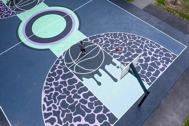 The basketball court at Marktetview Lodge was the first city court to received a fresh coat of paint courtesy of Peculiar Asphalt, a city-run program that brings Rochester residents, ages 16 to 20, together to design and paint murals on city basketball courts. - PHOTO BY NATE MILLER