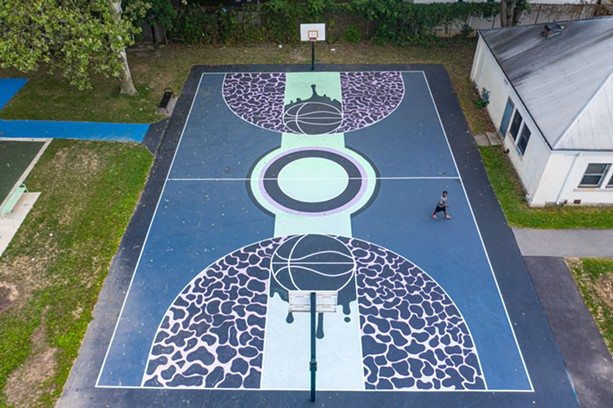 The basketball court at Marketview Lodge has seen much more action since receiving an artistic paint job from Peculiar Asphalt, says the program's facilitator Brittany Williams. - PHOTO BY NATE MILLER