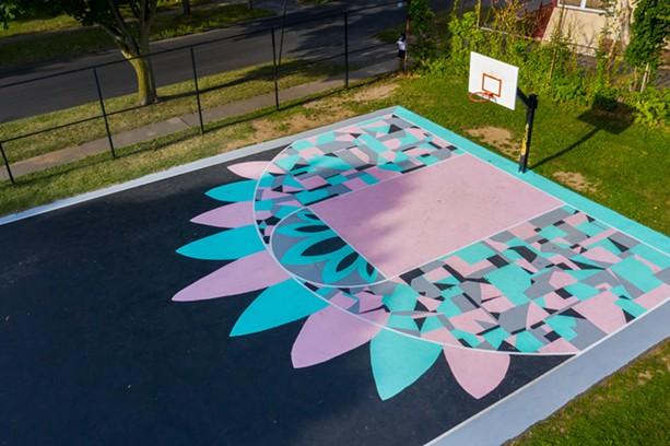 A Peculiar Asphalt mural at Tacoma Park R-Center. - PHOTO BY NATE MILLER