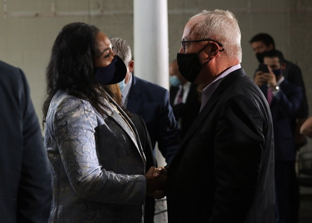 Mayor Lovely Warren chats with Constellation CEO Bill Newlands after Wednesday's announcement that the company plans to move its headquarters from Victor to downtown Rochester. - PHOTO BY MAX SCHULTE