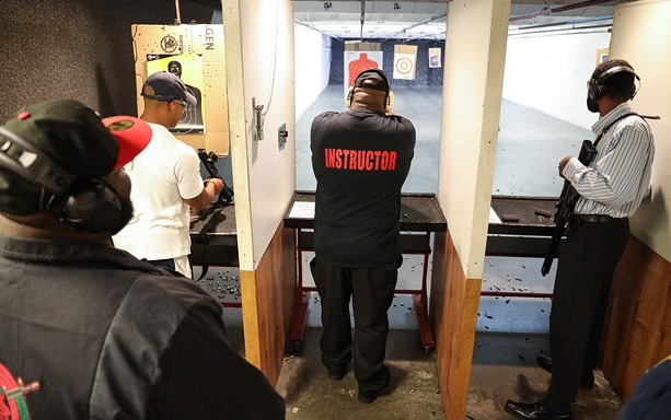 Members of the Rochester African American Firearms Association shoot targets at The Firing Pin. - PHOTO BY MAX SCHULTE