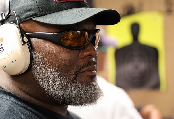 Mark Cochran, a former sergeant with the Monroe County Sheriff's Office, is the chief instructor for the Rochester African American Firearms Association. - PHOTO BY MAX SCHULTE