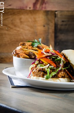 pulled pork BBQ sandwich with house BBQ sauce and vinegary vegetable slaw. - PHOTO BY MARK CHAMBERLIN