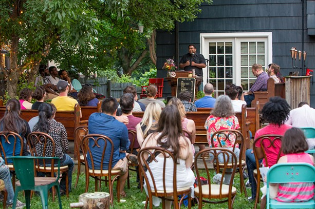 Ohio poet Scott Woods was a featured reader at the July 11 event. - PHOTO BY JOHN SCHLIA