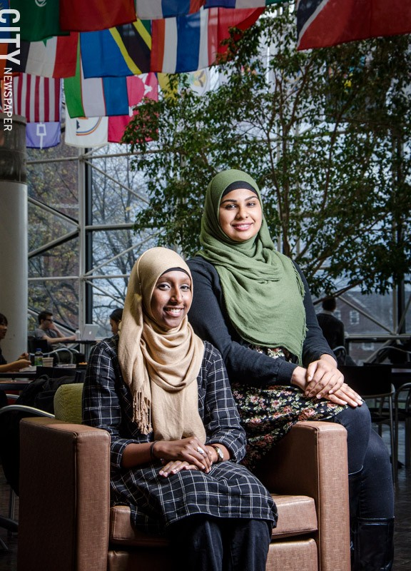 Manal Sidi, seated, and Lailun Nahar. - PHOTO BY MARK CHAMBERLIN