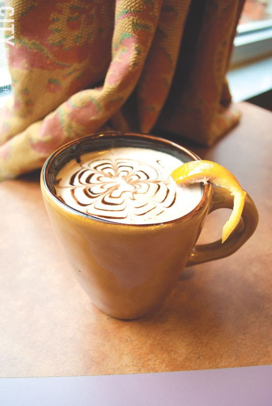 Dark Horse Coffee adds an orange slice and cranberry flavoring for a tangy latte. - PHOTO BY RYAN WILLIAMSON