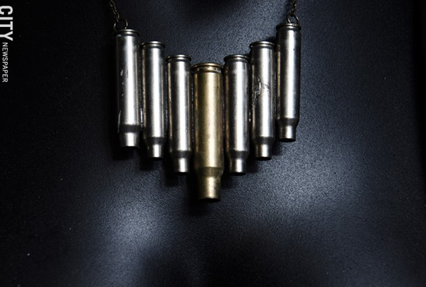 A necklace using bullet casings made by Grimble. - PHOTO BY MARK CHAMBERLIN
