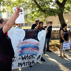 Latinos Unidos held a protest yesterday in solidarity with B.L.A.C.K. and Black Lives Matter. - PHOTO BY TIM MACALUSO