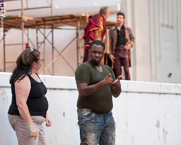 """Members of Dangerous Signs interpret a production of """"Romeo and Juliet"""" at Highland Bowl. The group is now rehearsing for shows taking place at the Rochester Fringe Festival in September. - PHOTO BY JOSH SAUNDERS"""