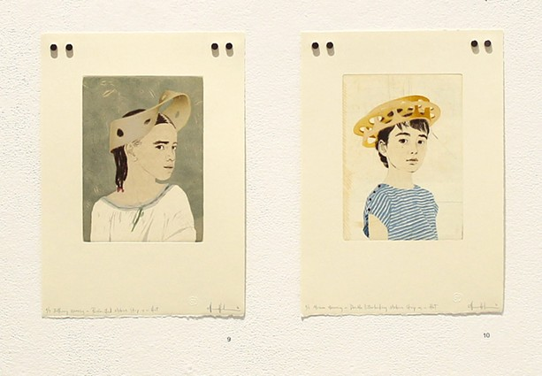 """Installation view of Ellen Heck's """"Fascinators"""" series of portraits of young girls with Mobius Strips for hats. - PHOTO PROVIDED"""
