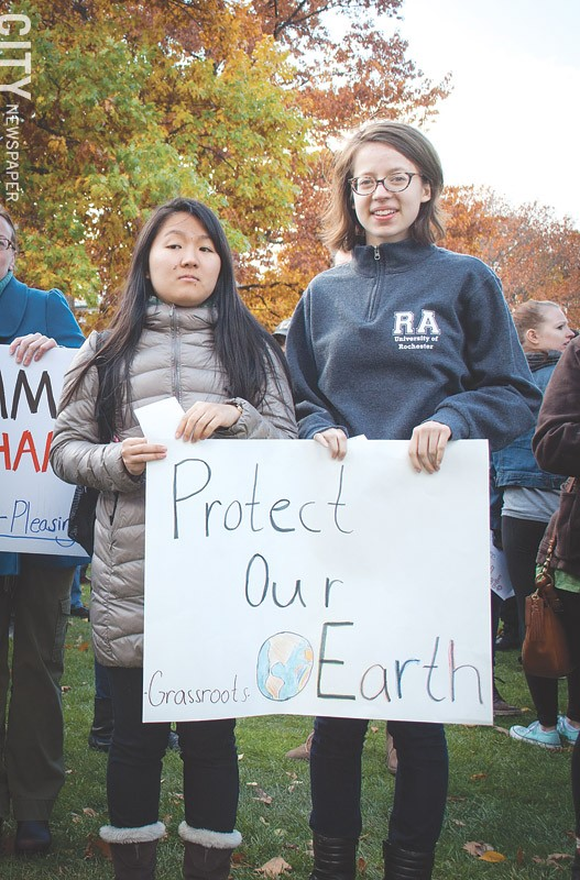The Trump administration has proposed doing away with important environmental and climate - programs and rules. During a November anti-Trump rally at the University of Rochester, several participants showed their concern. - PHOTO BY RYAN WILLIAMSON