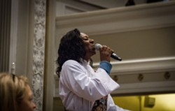 The Rev. Myra Brown sings at her ordination ceremony. - PHOTO BY KEVIN FULLER