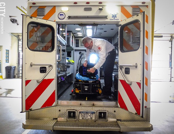 James Bucci, Henrietta Ambulance's executive deputy chief, prepares one of the company's vehicles. - The ambulance company is merging with Chili Volunteer Ambulance Service and Scottsville Rescue Squad. - PHOTO BY KEVIN FULLER