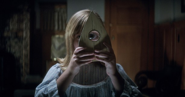 "Lulu Wilson spies something sinister in ""Ouija: Origin of Evil."" - PHOTO COURTESY UNIVERSAL PICTURES"